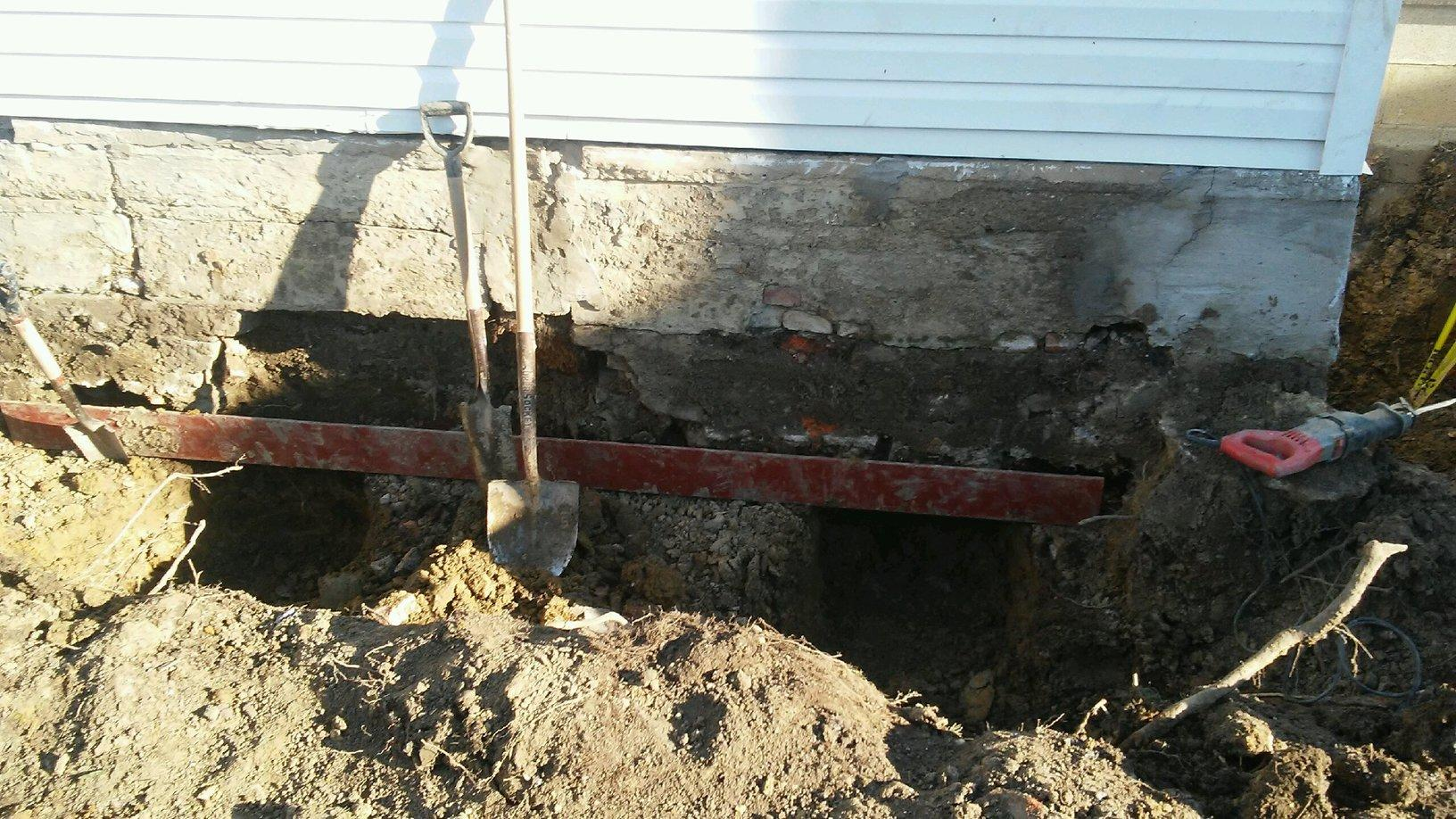 Foundation Repair Shoring Helical Pier Installation In Getzville Ny Problem Area With Sinking Foundation
