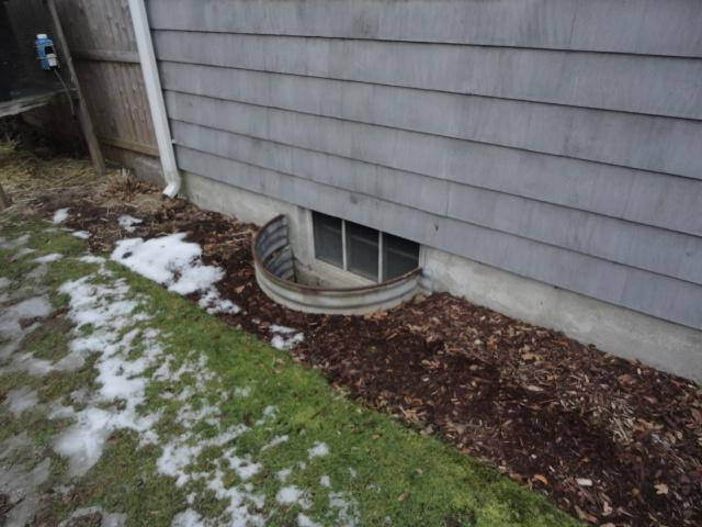 A View of an Outside Basement Window from a Home in Bridgeport, CT