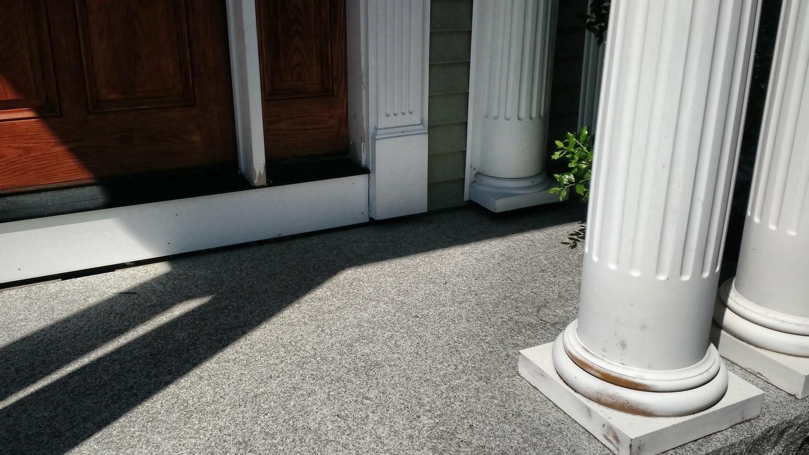 Sunken granite step with portico