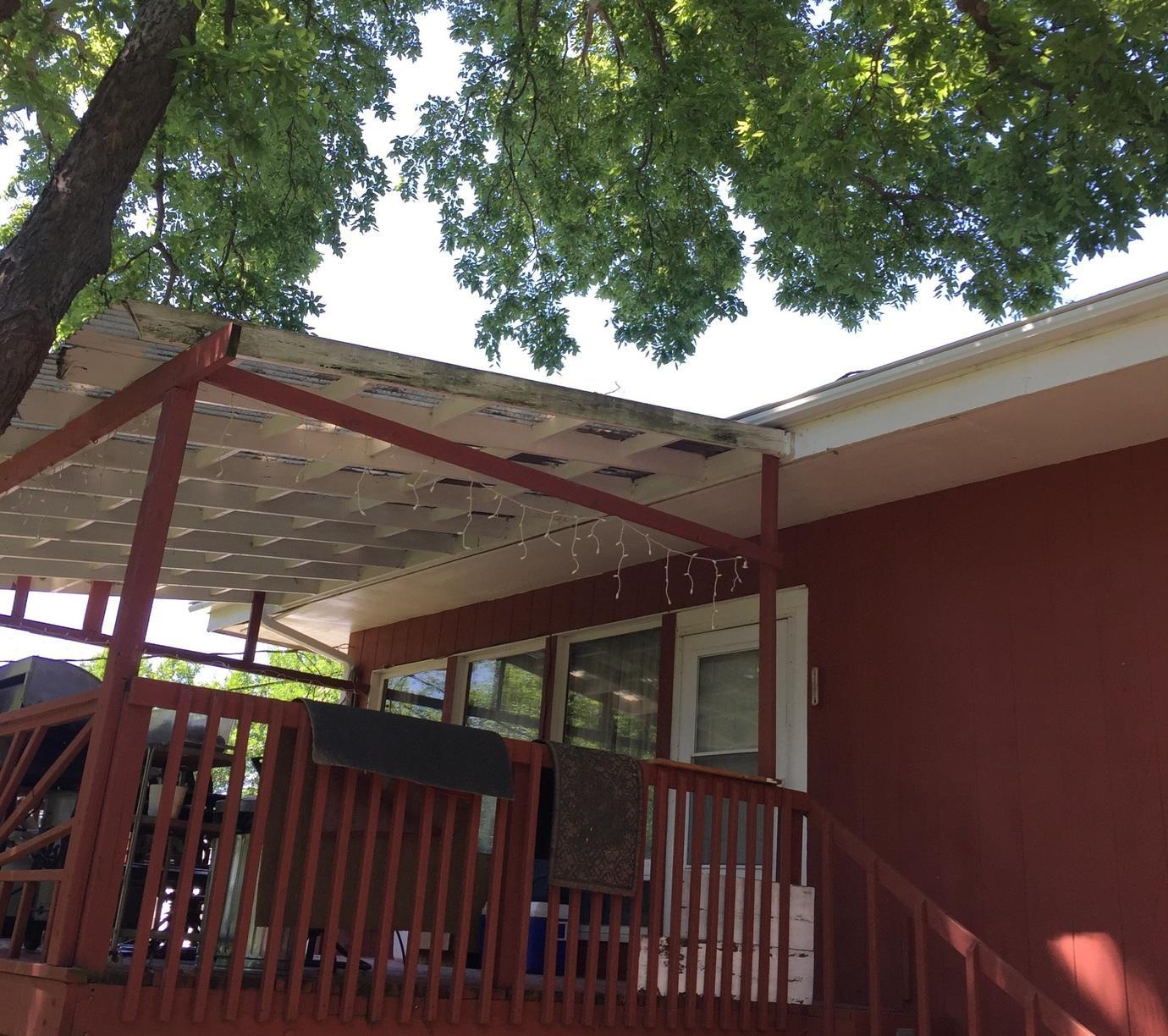Installed LeafGuard Brand Gutter System Over Covered Deck - Bellevue, NE