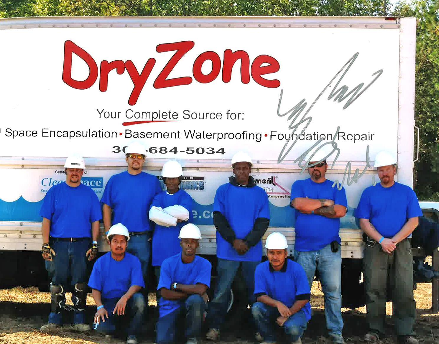 DryZone Team Photo Autographed By Ty Pennington