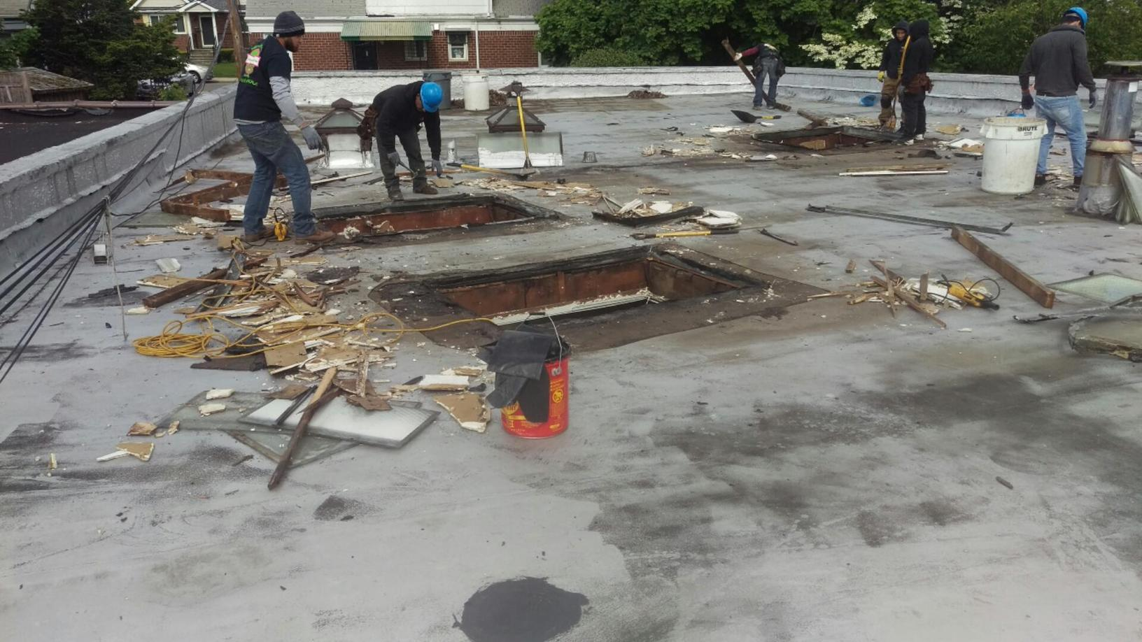 Our crew workin on roof