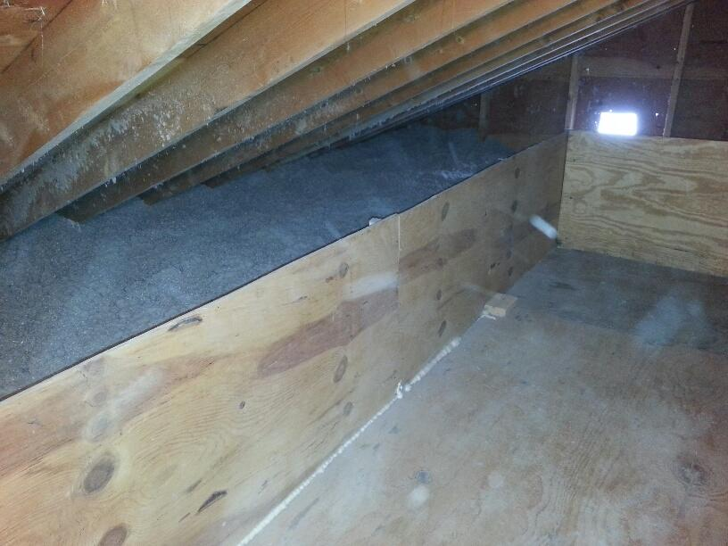 Storage deck with loose filled cellulose surrounding