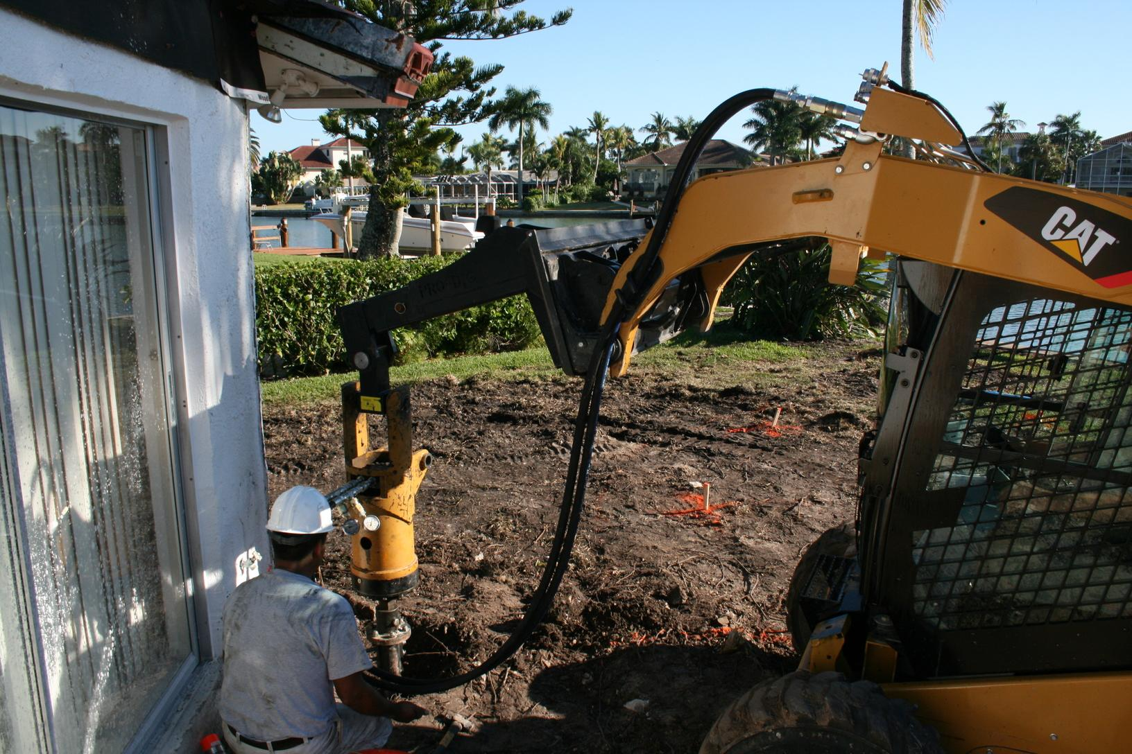 Installation adjacent to house with skidsteer
