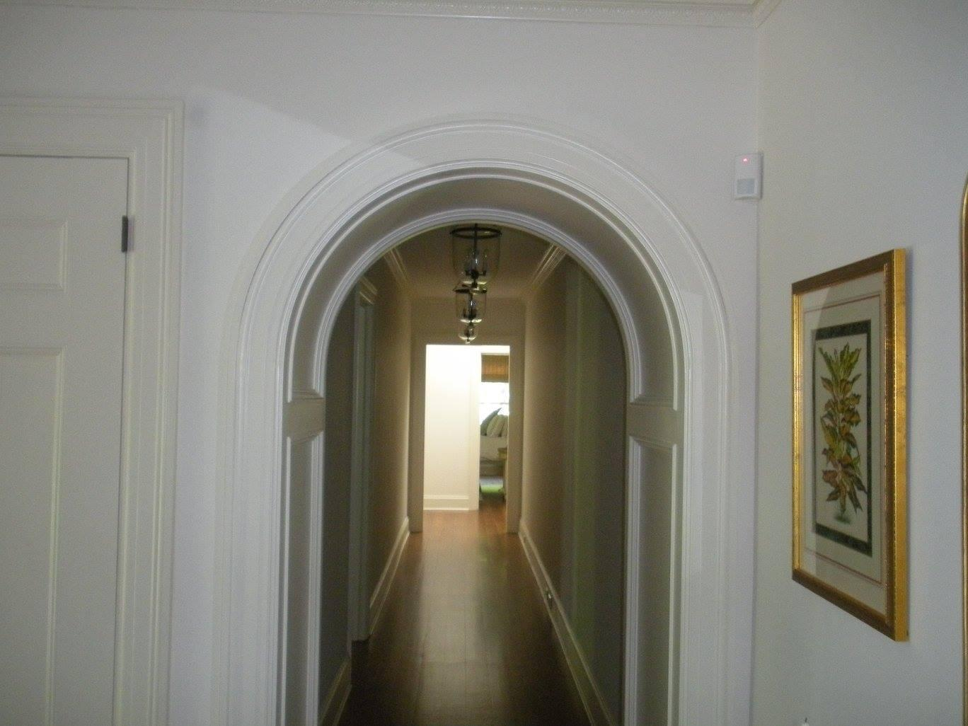 Hallway with Arched Entrance