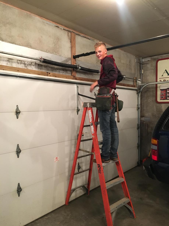 Broken Spring on Garage Door Repaired in Duluth.
