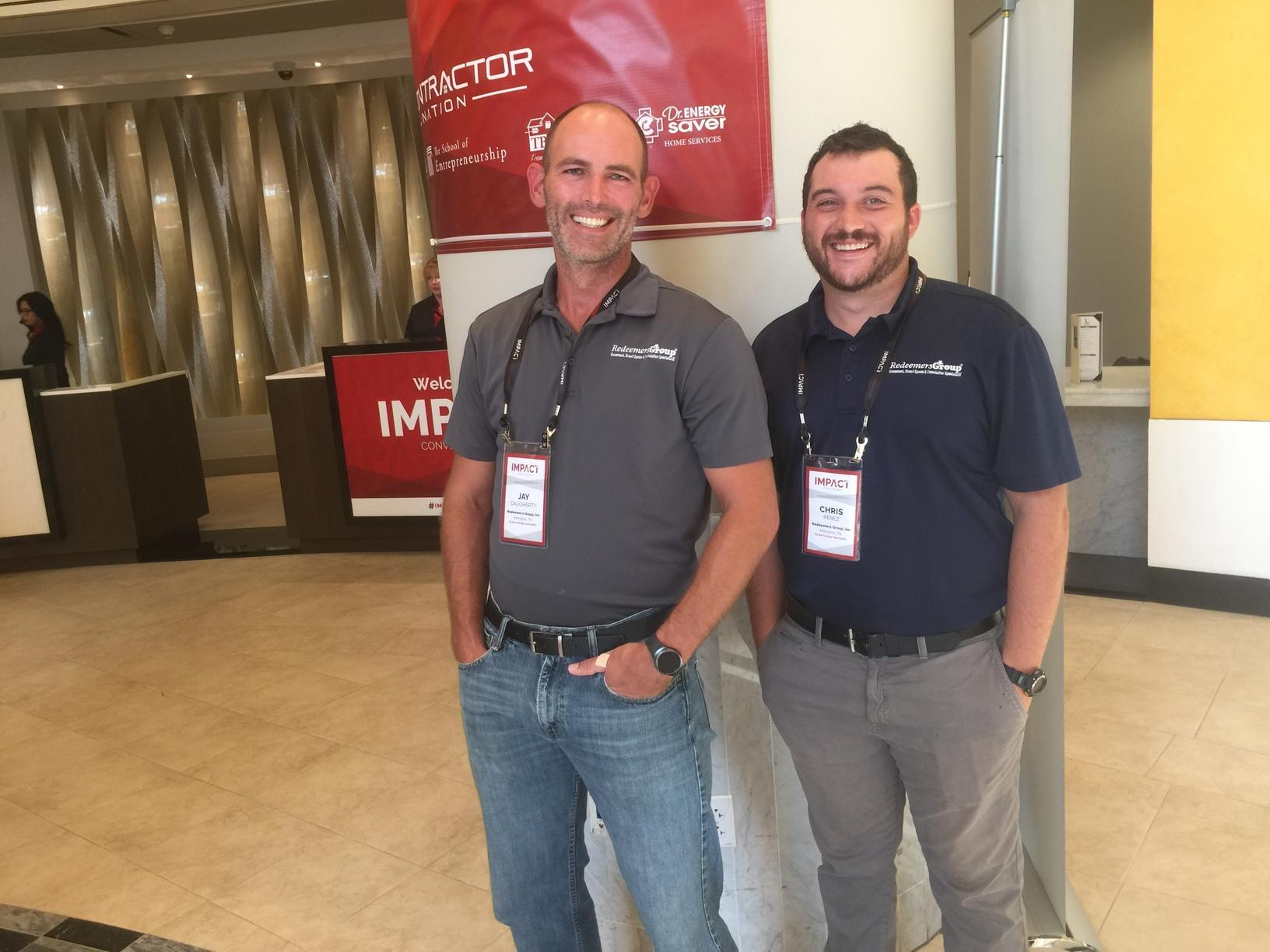 2 team members take in all that is going on around them at Impact Convention 2017
