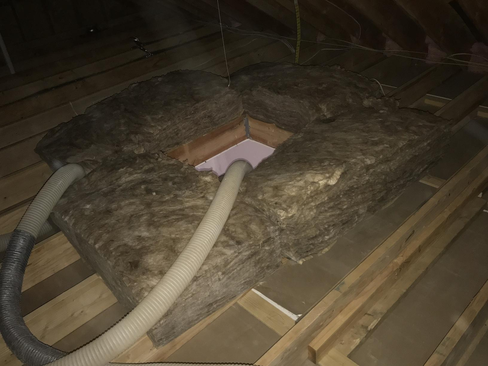 Unfaced fiberglass batts being used as a dam around the scuttle hatch