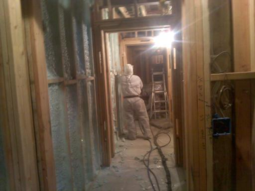 John installing closed cell spray foam on the walls of this basement