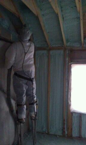 Henry is installing spray foam to this addition space.