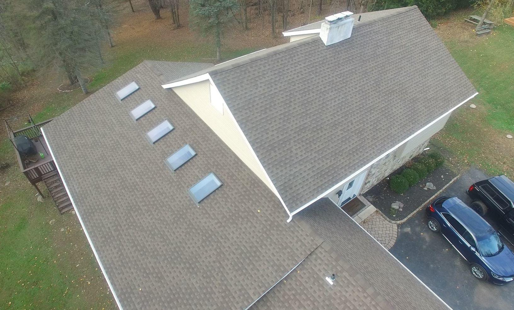 Multiple Tiers of Roofs, and Vinyl Siding