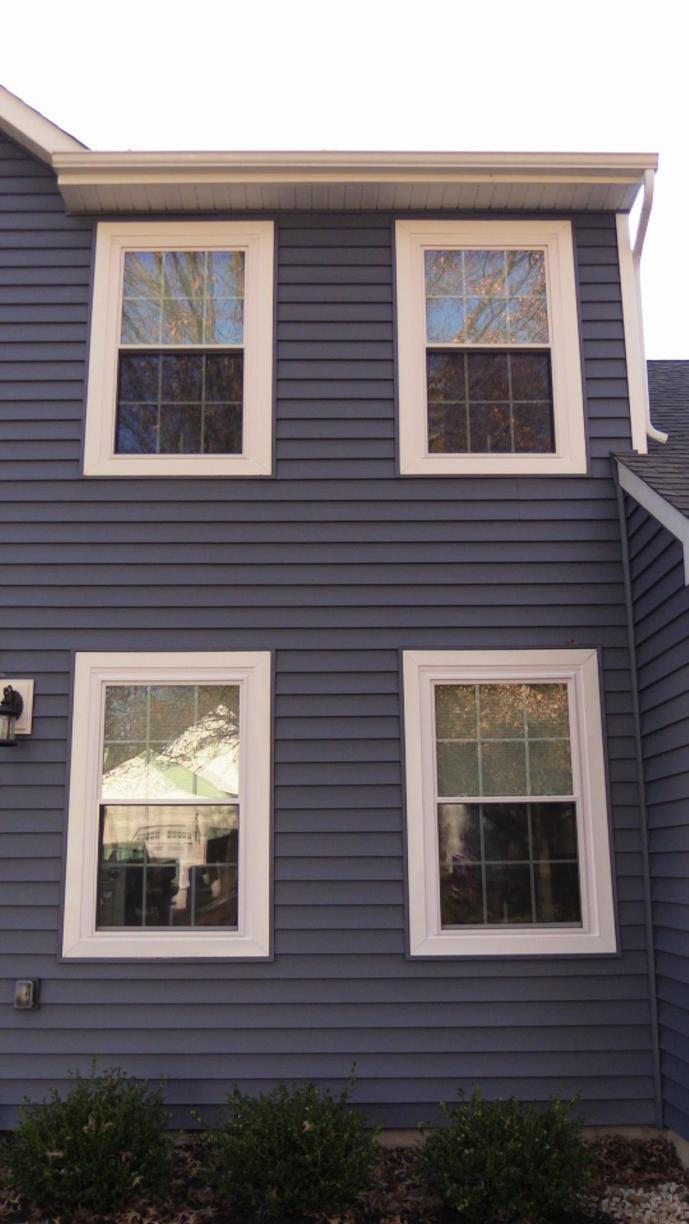 Gutters Installed, Windows Installed, Windows Capped, and New Vinyl Siding... One Big Job