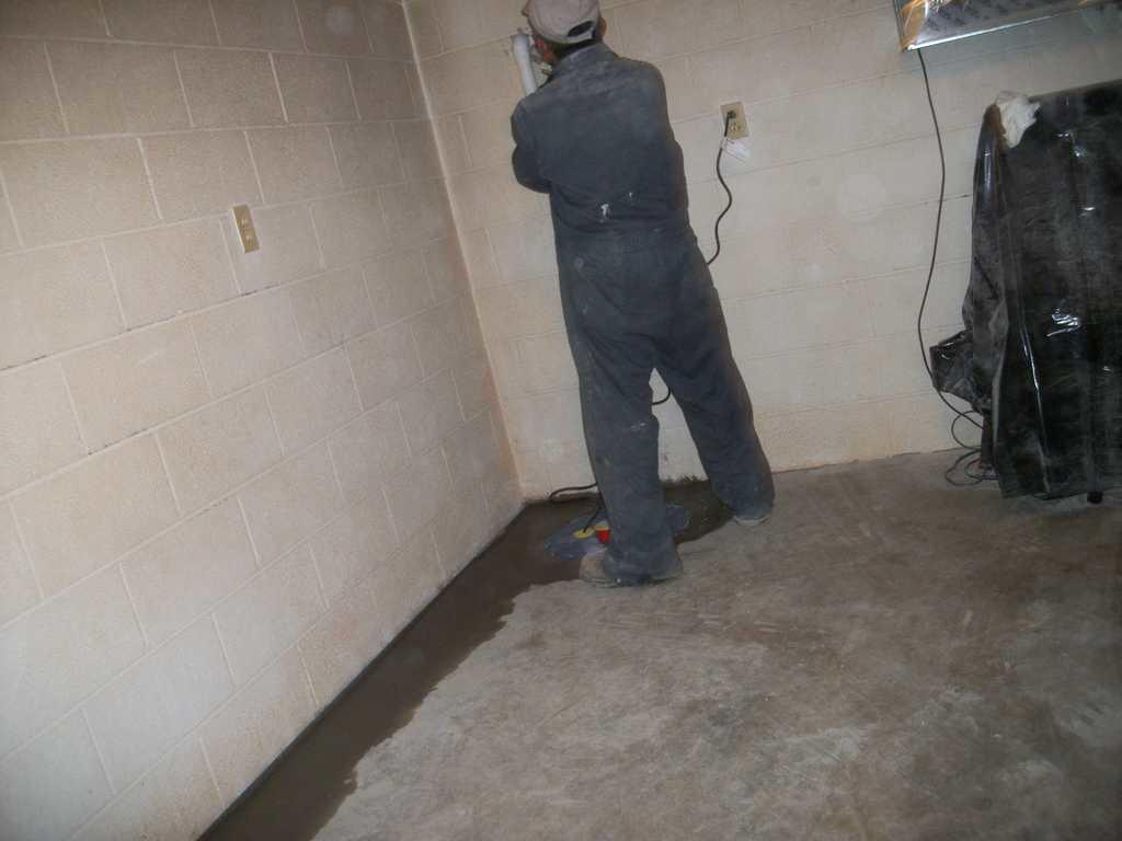 Crew Working on Sump Pump Installation