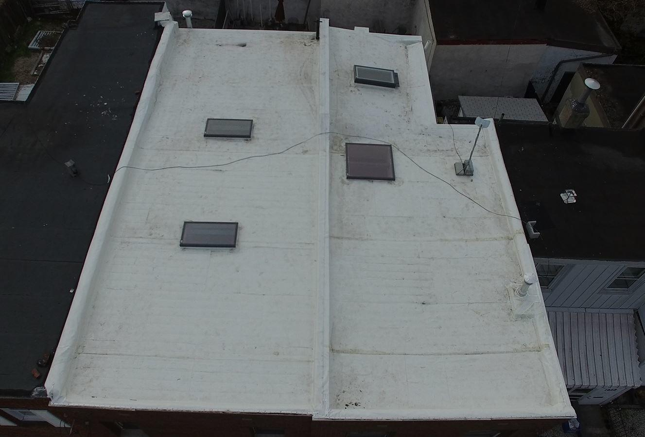 White Flat Roof and Skylights Installed by Pinnacle Exteriors Skilled Installation Staff in Philadelphia, PA