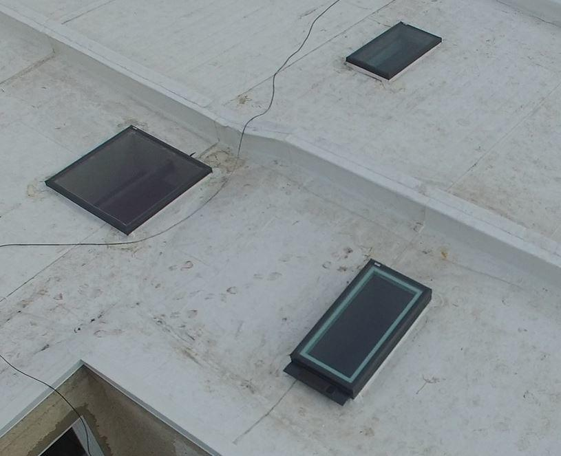 A New White Flat Roof, New Skylights To Go Along