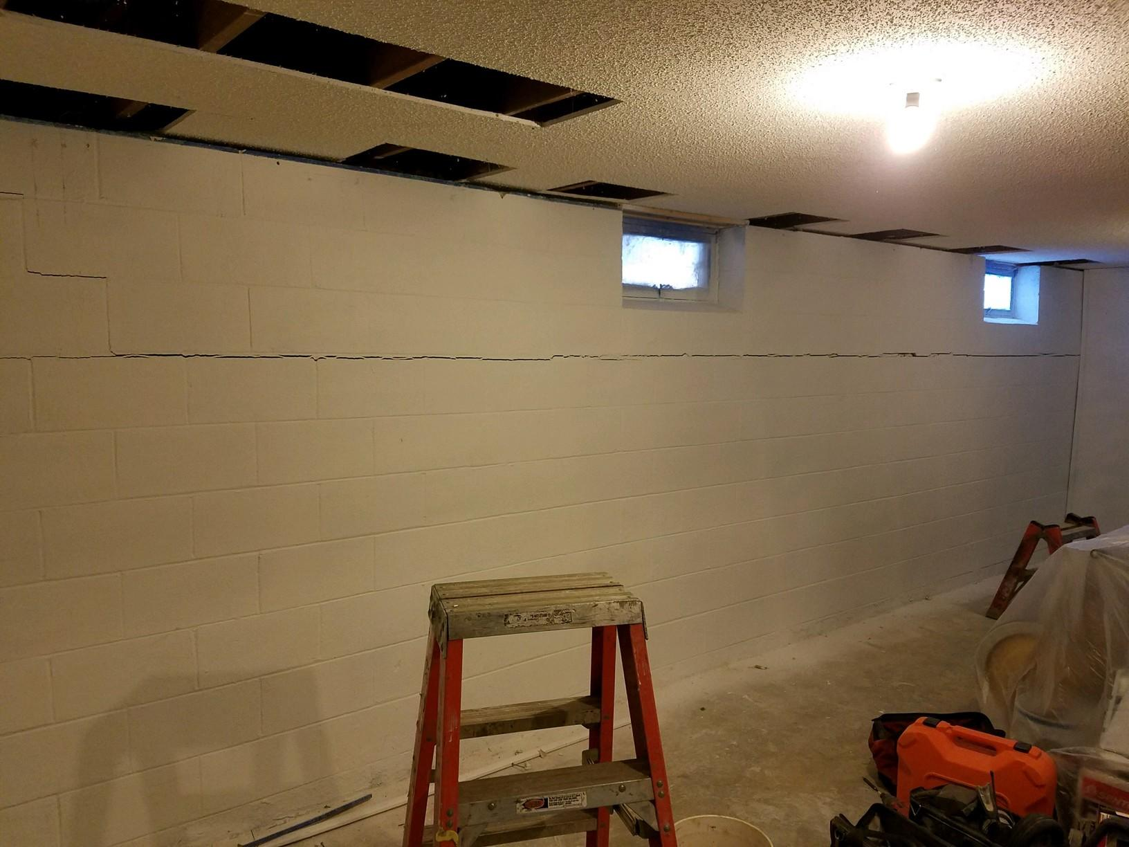 Before basement wall repair system with finished ceiling