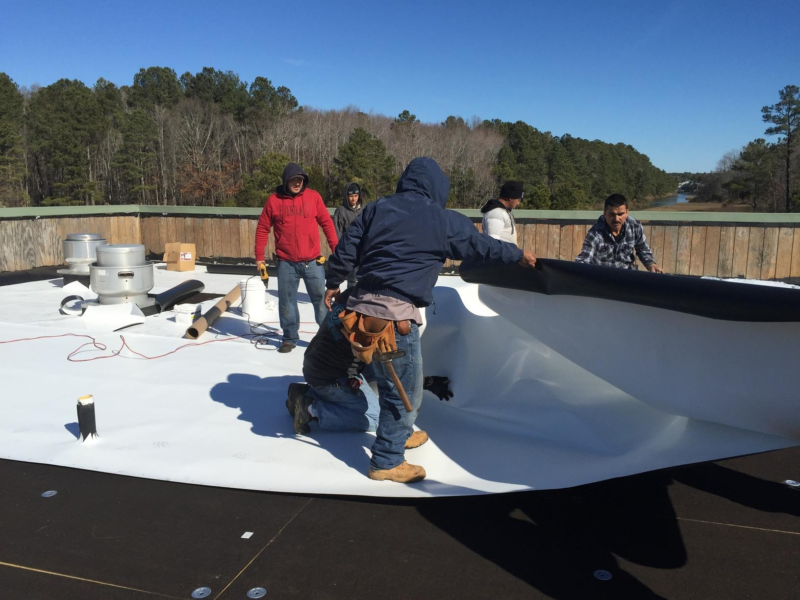 Laying Down the TPO Roofing
