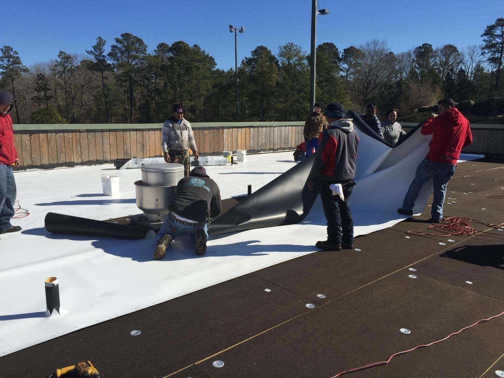 Our Team Installing TPO Roofing.