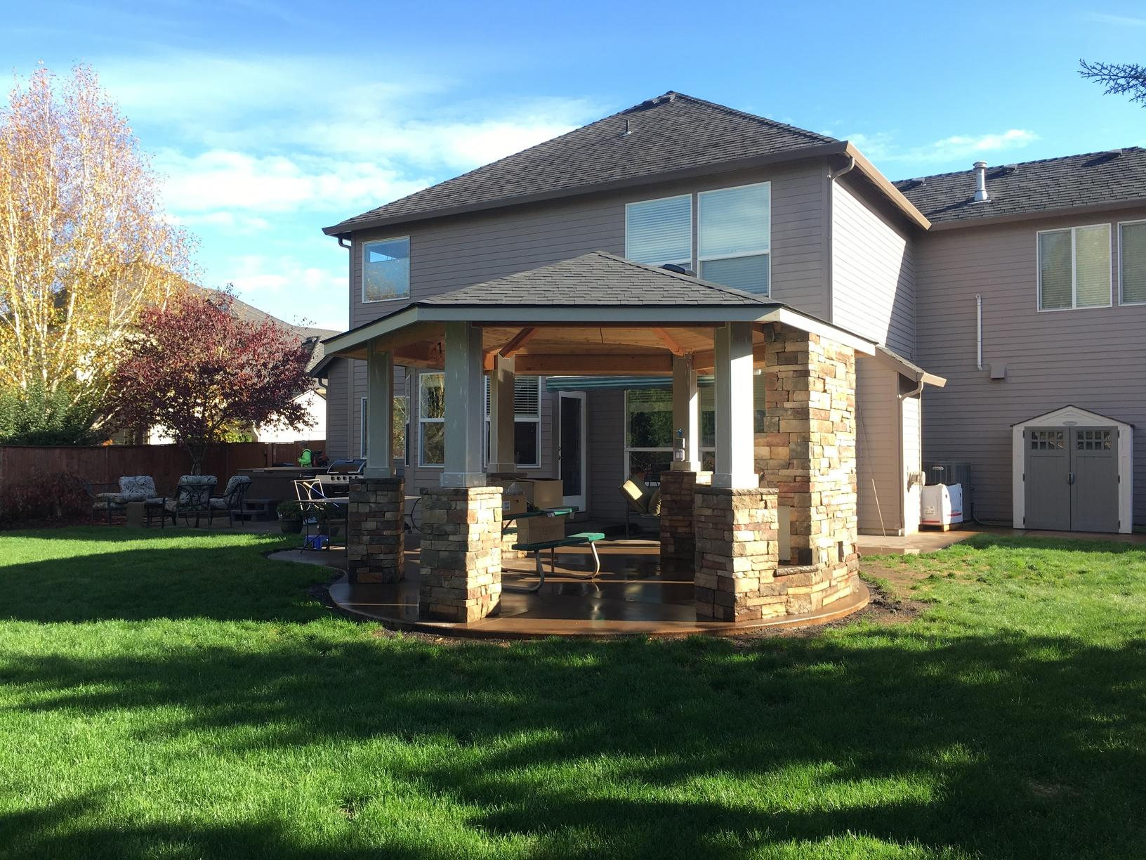 Home in Vancouver, Washington gets a six sided stand alone patio cover with gas fire place