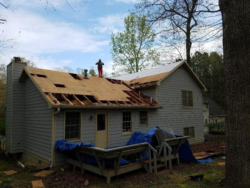 Tearing off the old roof