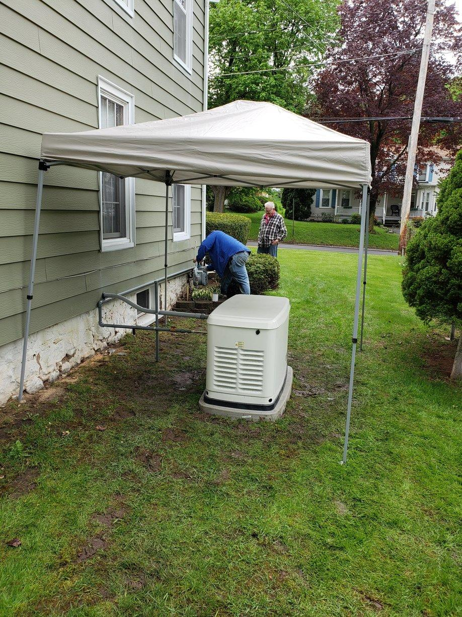 Marion, NY homeowner inspecting the fine workmanship of our technician