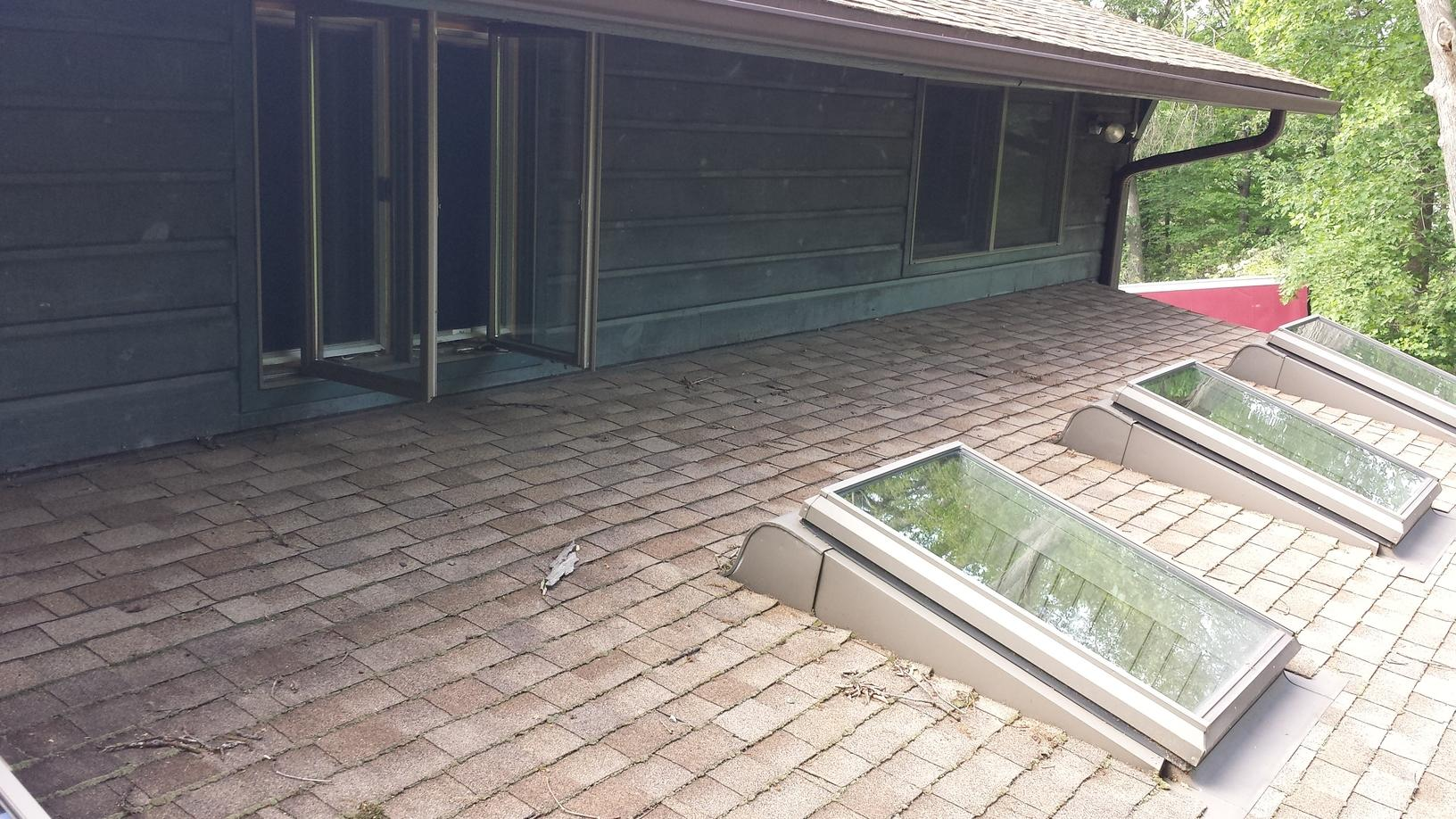 Before Photo of Multiple-Layered Asphalt Roof Needing Replacement