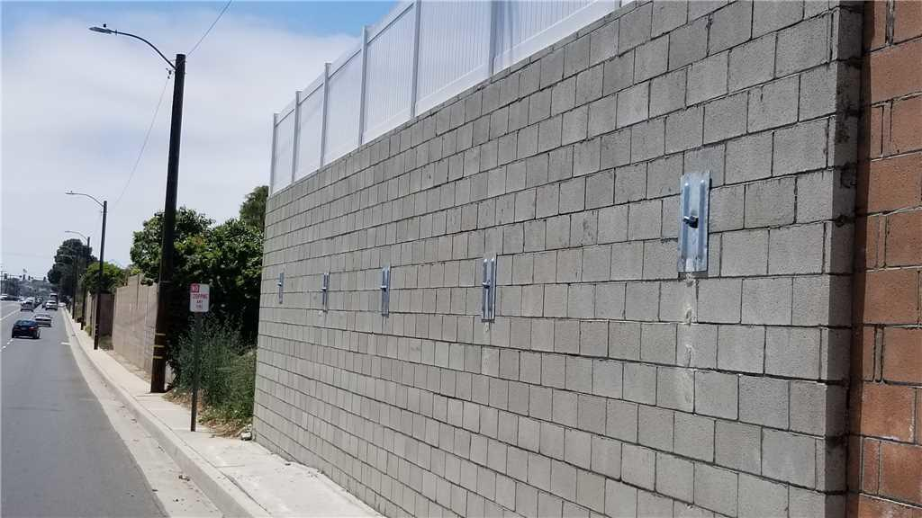 Applying Tension with Helical Tiebacks to Save a Block Wall in Torrance