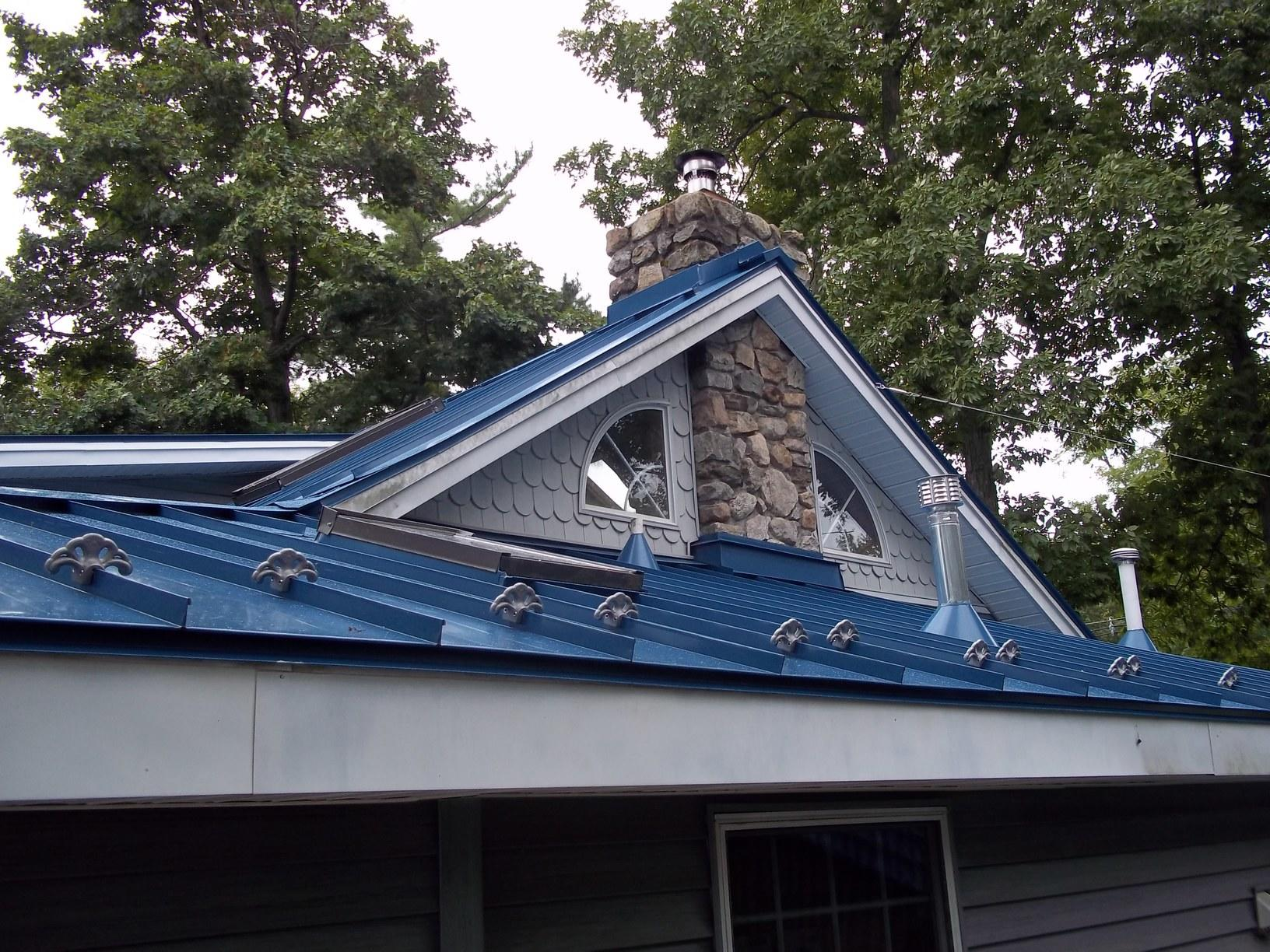 Blue Metal Roof with Stone Chimney