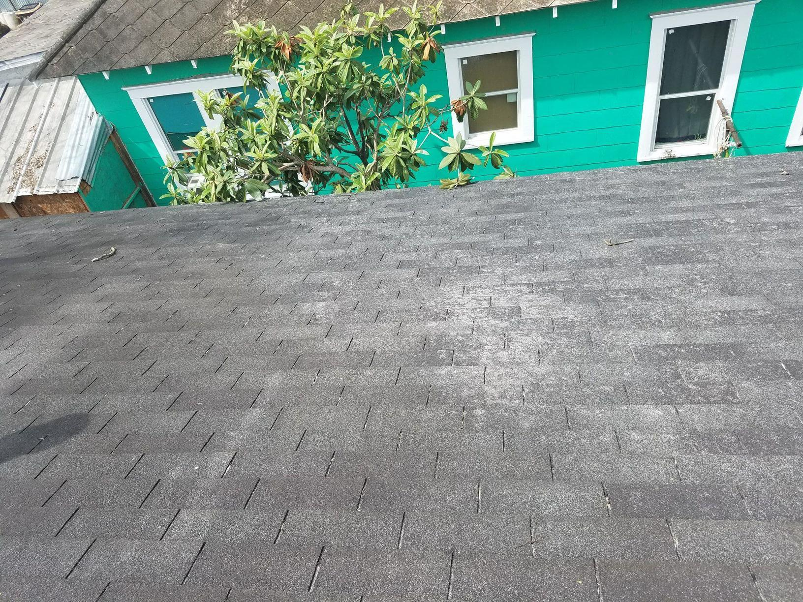 Damaged Roof Before Replacement