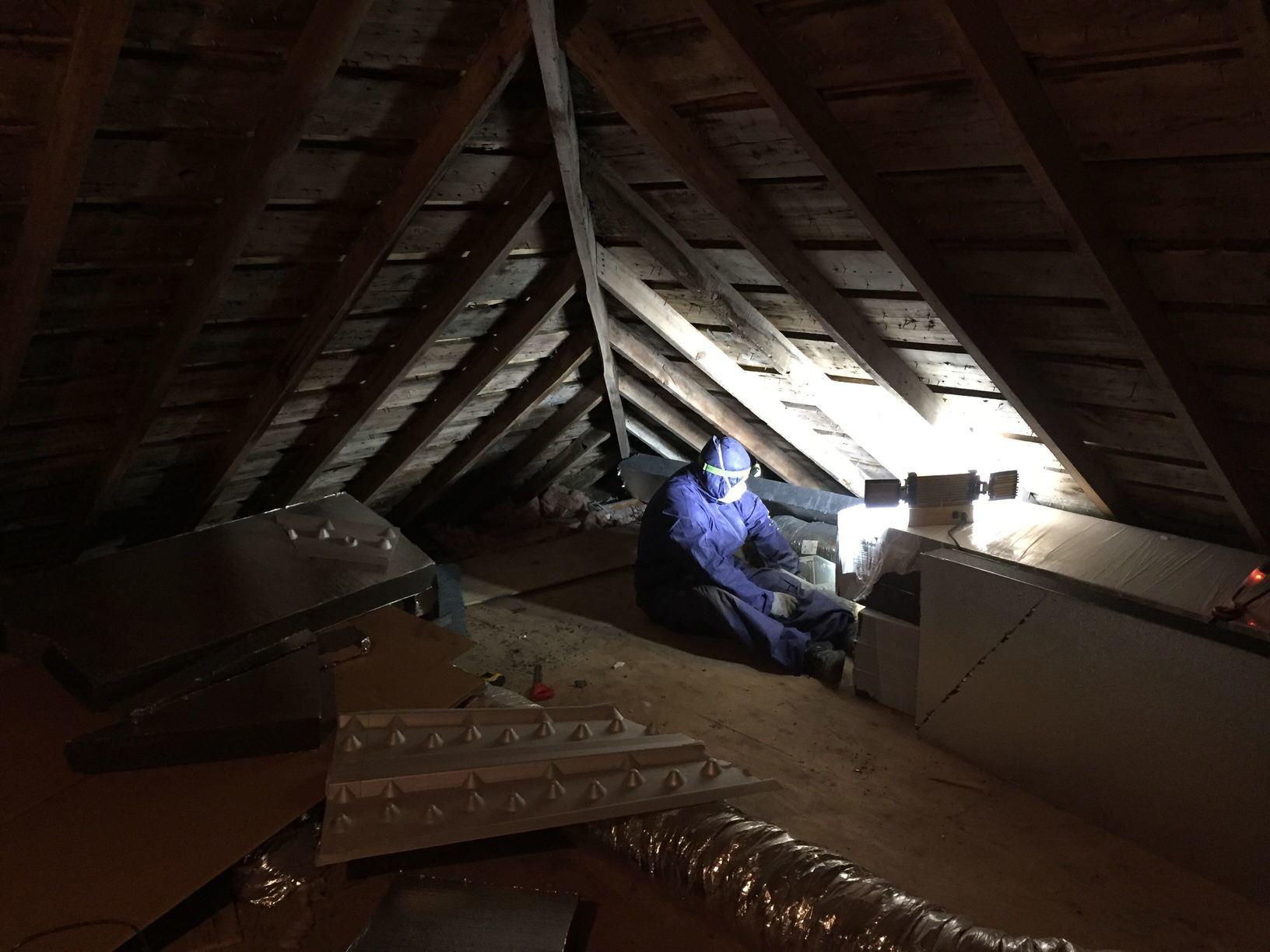 Installing attic insulation in Techny