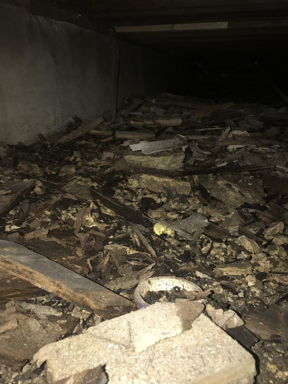Debris Left in Crawl Space