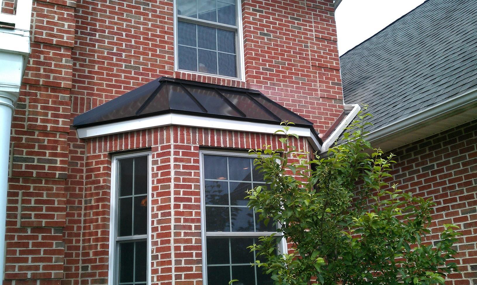 Installing Custom-Shaped Matte Black Standing Seam Metal Roof over Bay Window