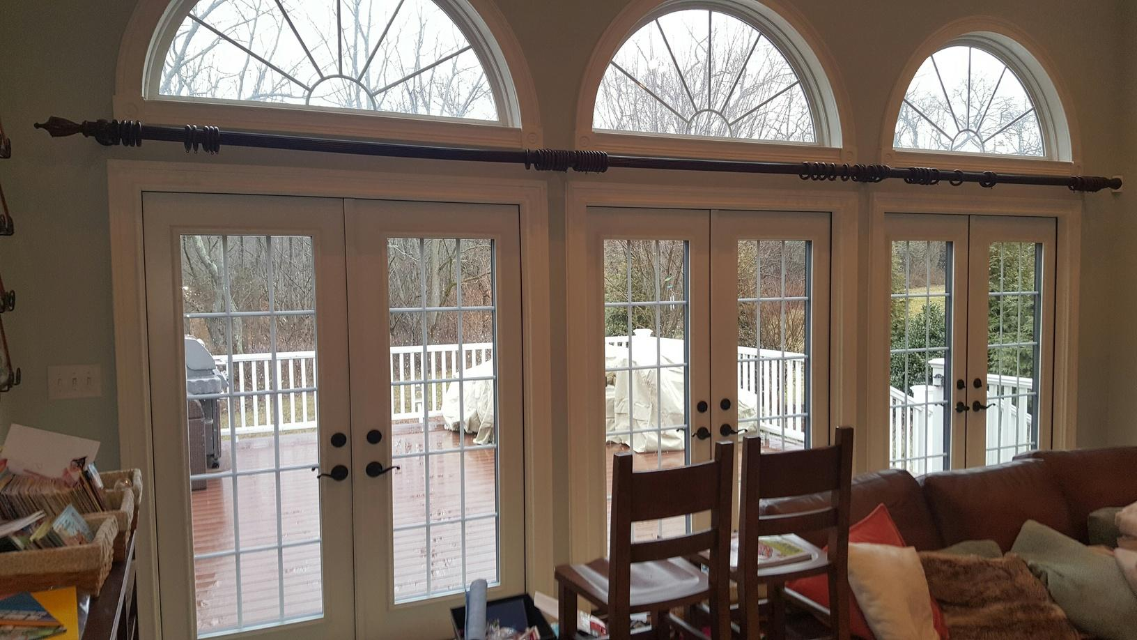 Custom French Outswing Patio Doors with Colonial Grids, Aged Bronze Hardware, Snow White Interior, Coal Black Exterior