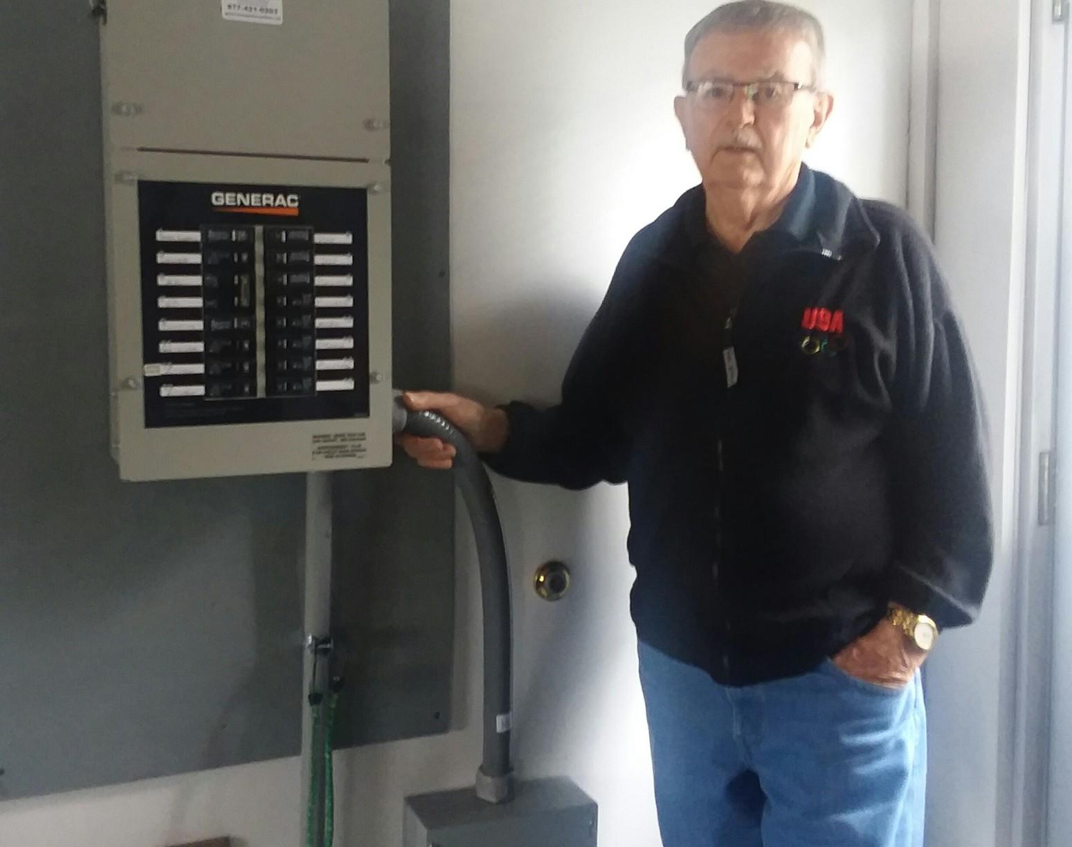 This satisfied customer proudly poses with his transfer switch