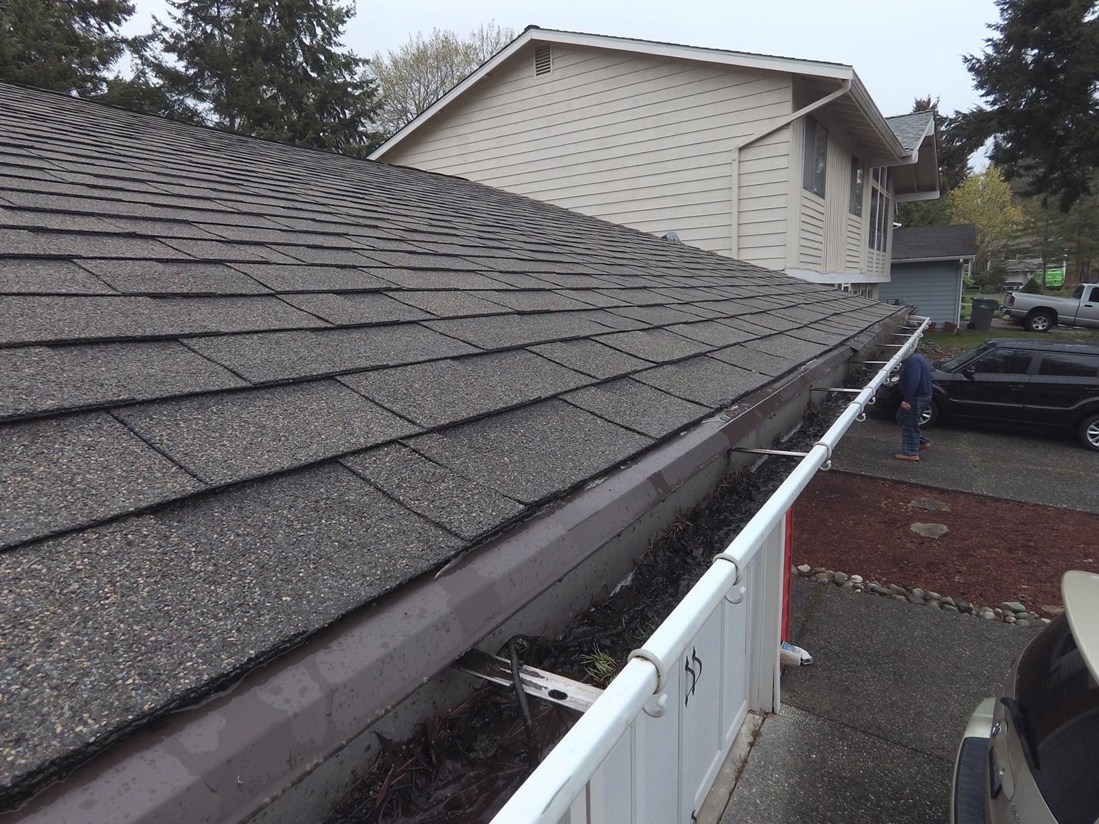 Filled Gutters on a Kirkland Roof