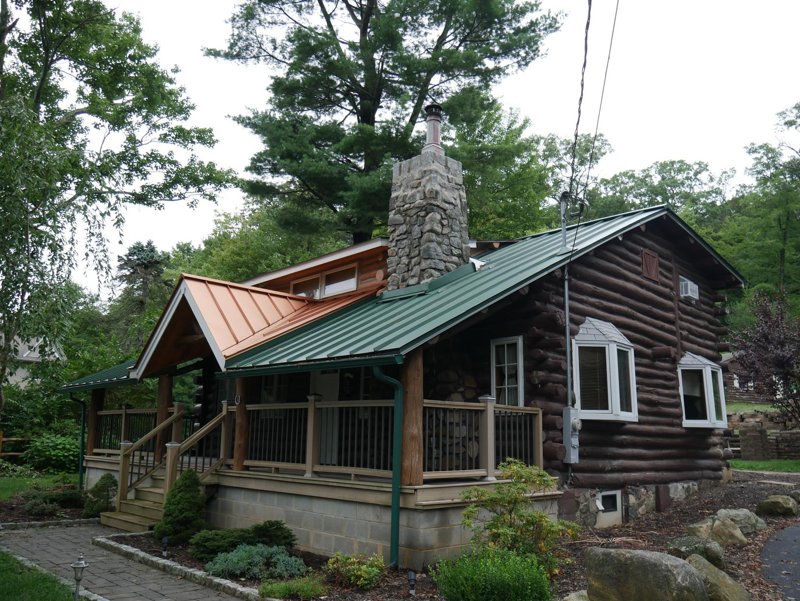 Custom Metallic Copper and Forest Green Standing Seam Metal Roof Installation on Log Cabin in West Milford, NJ