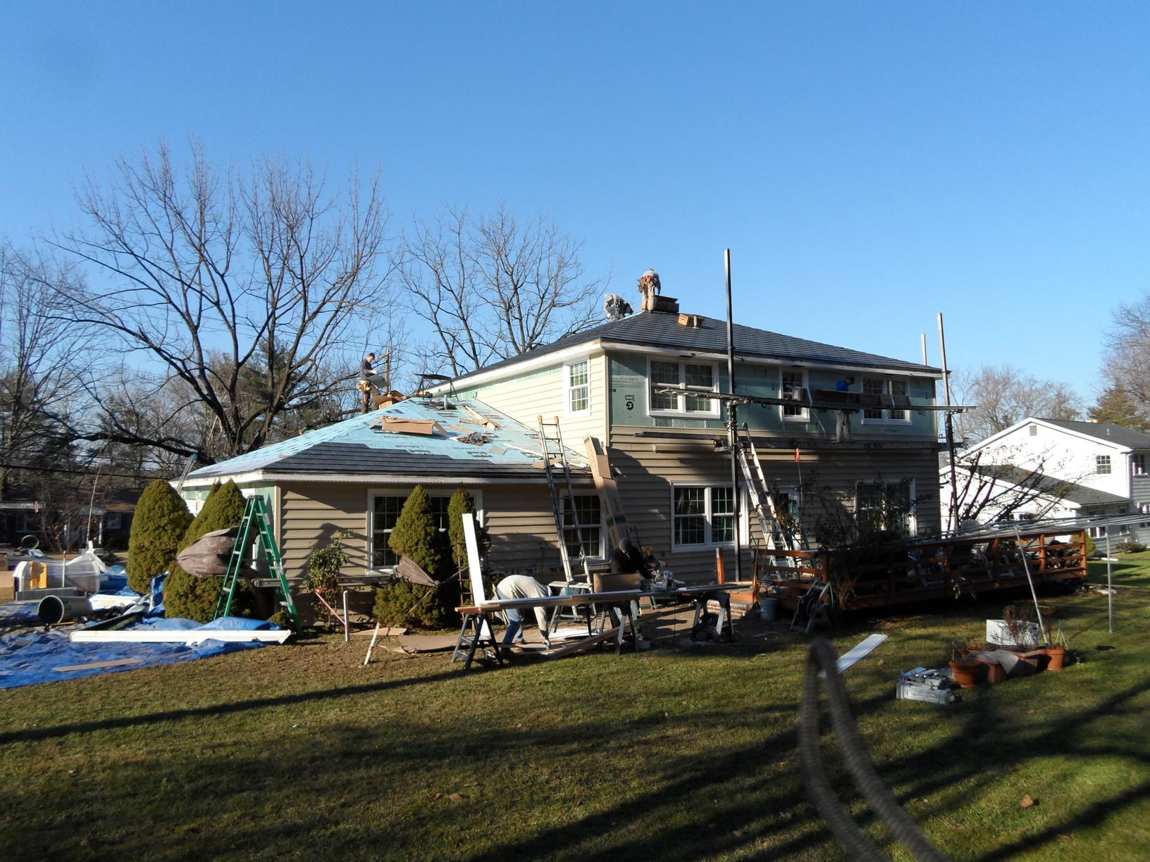 Progress Photo of Insulated Vinyl Siding and Metal Slate Roof Install in PA