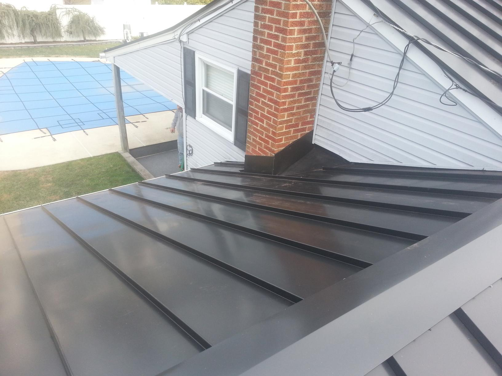 Matte Black Standing Seam Metal Roof with Custom Chimney Flashing Installed in Haddon Heights, NJ