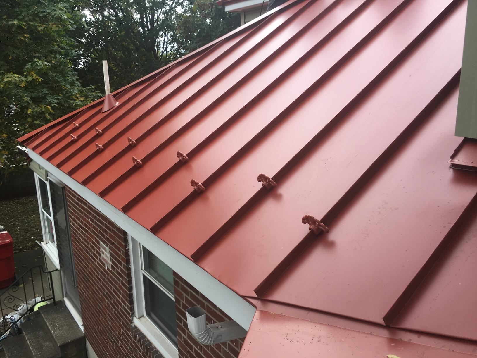 Terra Cotta Drexel Standing Seam Metal Roof with Snow Guards