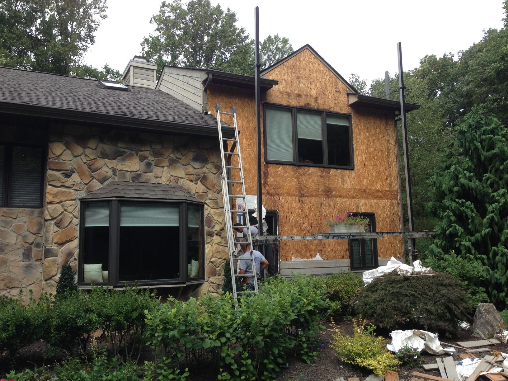 Light Moisture Damage Under Wood Siding