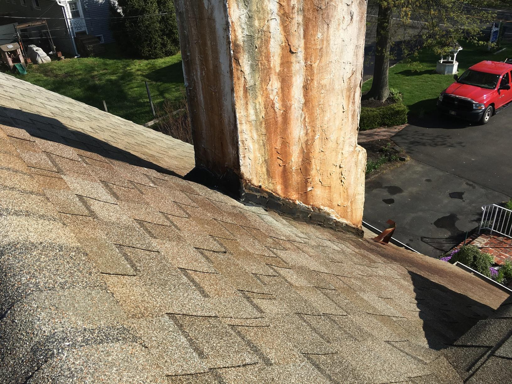 Discoloring on Shingles and Around Chimney