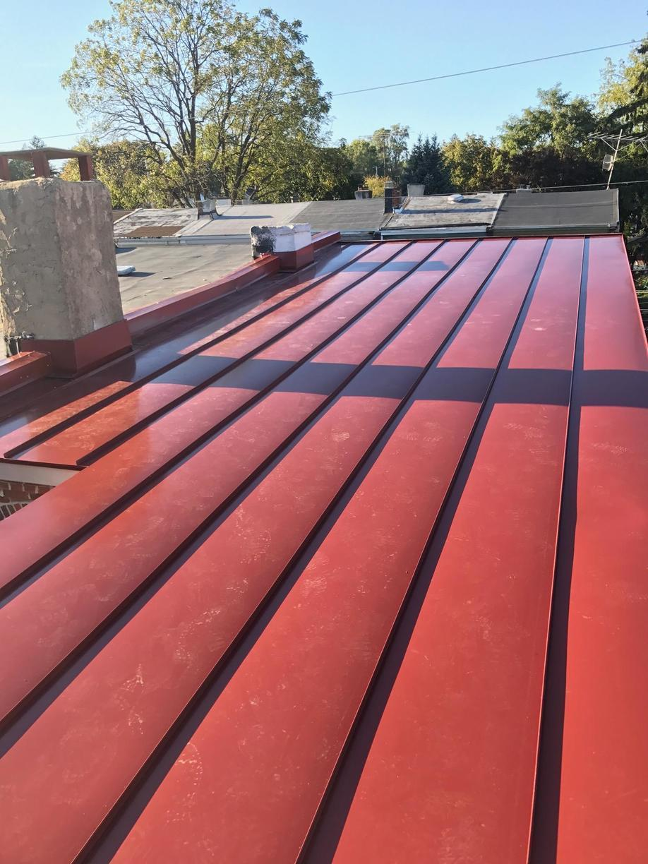 Installing Colonial Red Standing Seam Metal Roof On Flat