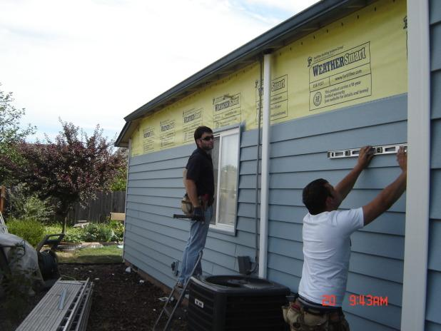 Our Team Installing Siding
