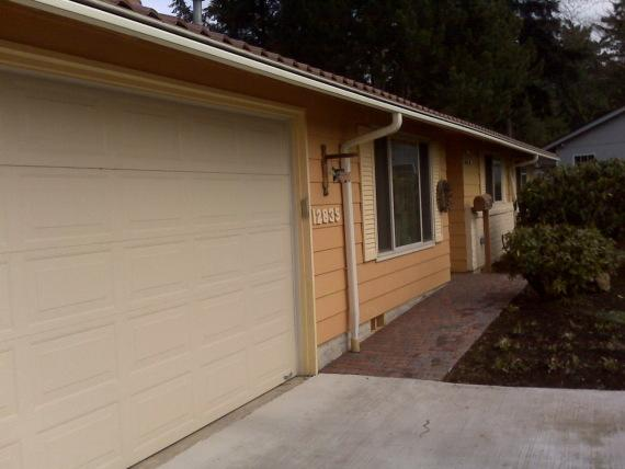 Siding Removal on Home and Garage
