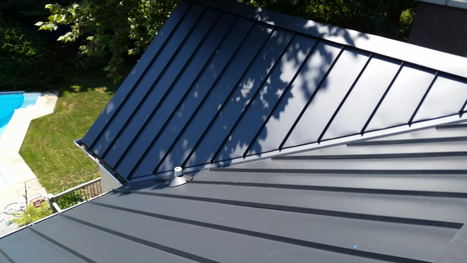 Grey Standing Seam Metal Roof Install