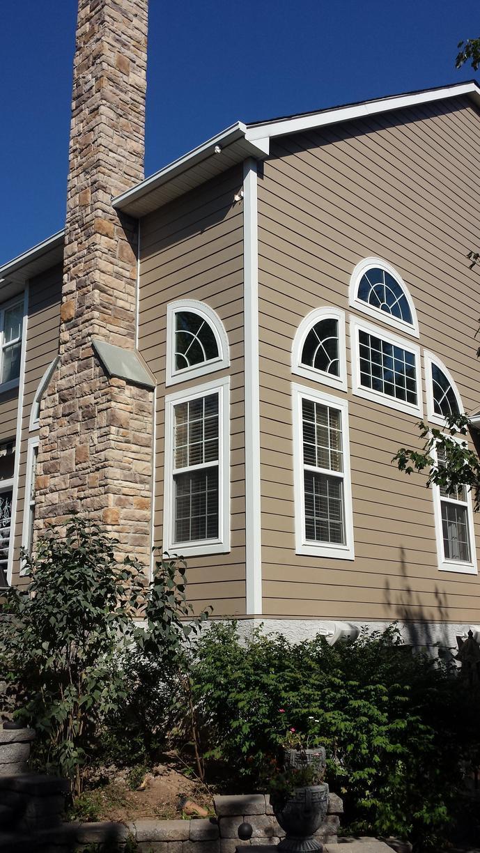 Installing Khaki Brown Hardie Planks Around Complex Windows