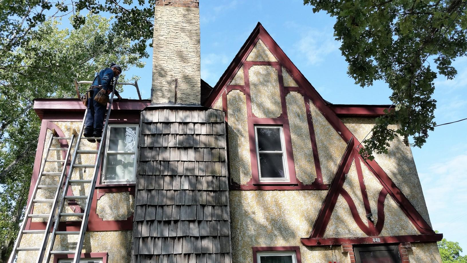 Matt Installing Gutters on Two Story Home - Dassel Minnesota