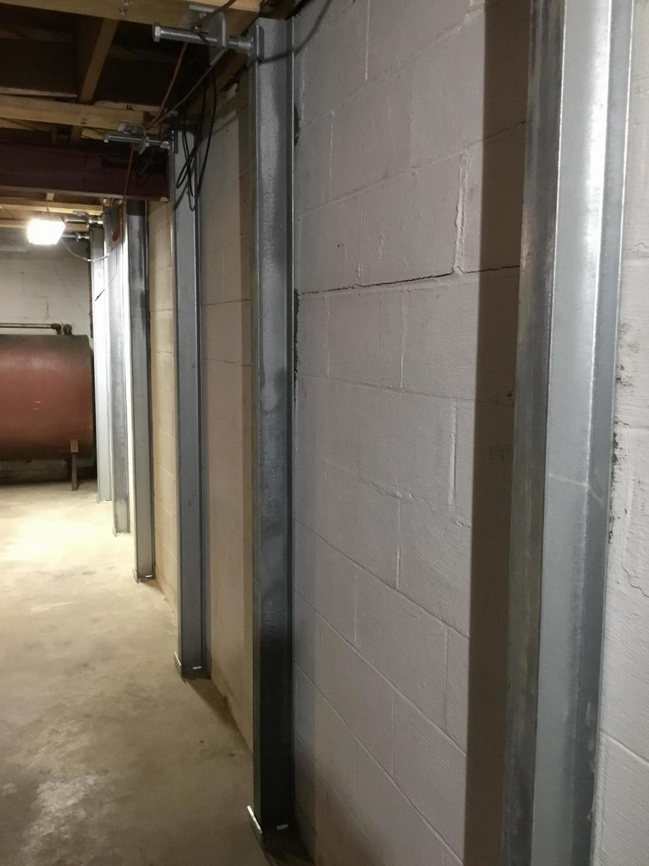 PowerBrace used to stabilize bowing basement wall.