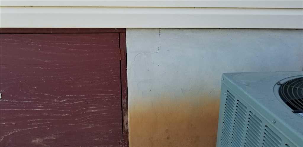 Foundation crack near crawl space door