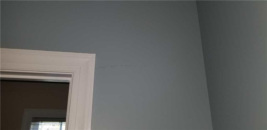 The sinking action of the house caused the drywall to tear